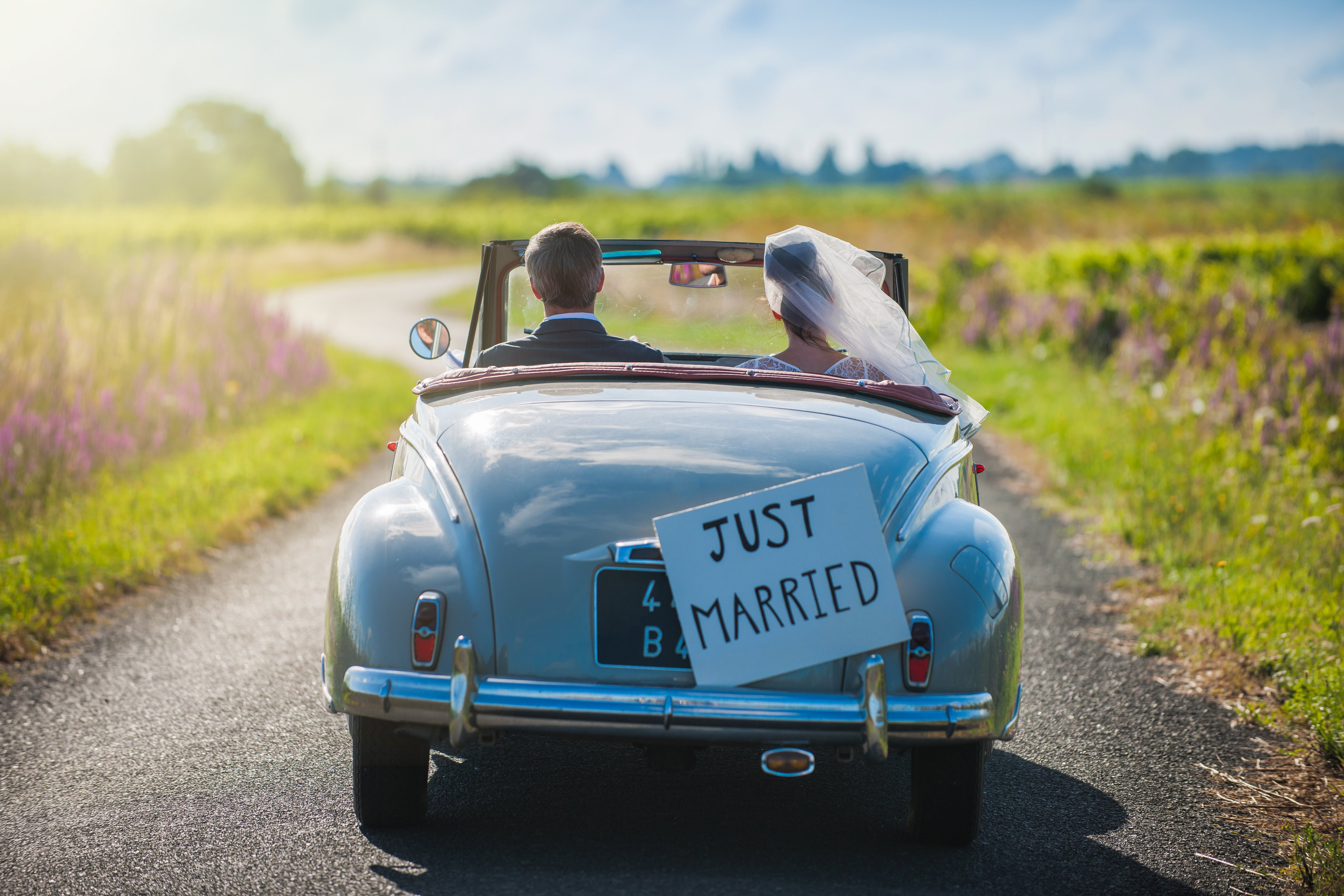 just married couple driving away