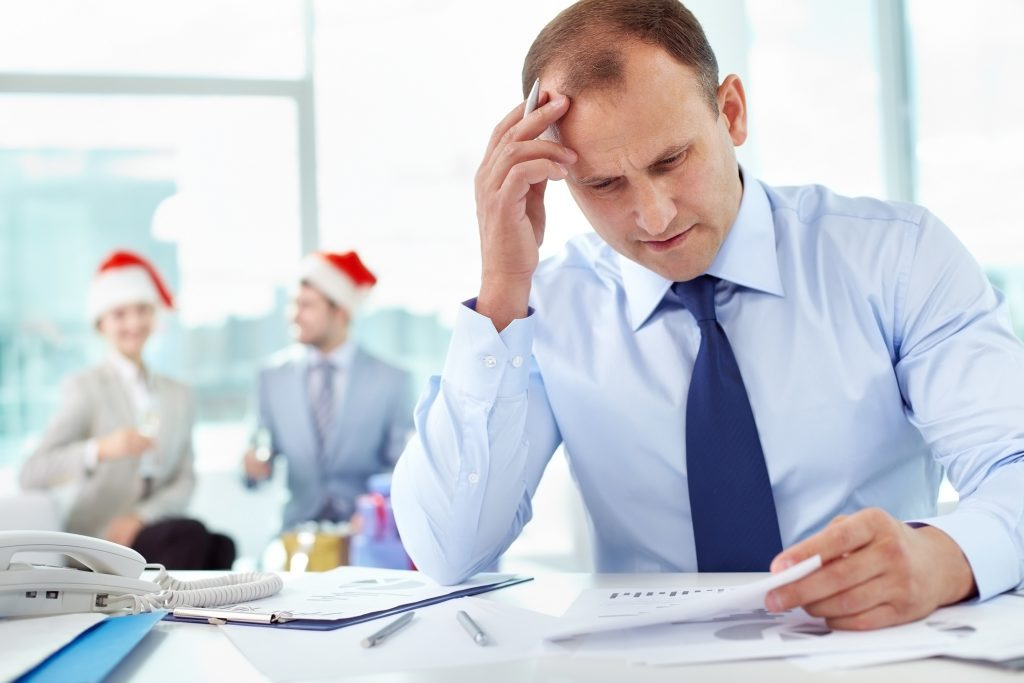man working in an office during the holidays